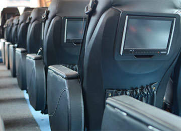 Leather seats and video entertainment system onboard Odyssey express bus